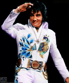 Elvis Blue Nail Jumpsuit Elvis on Tour cross necklace