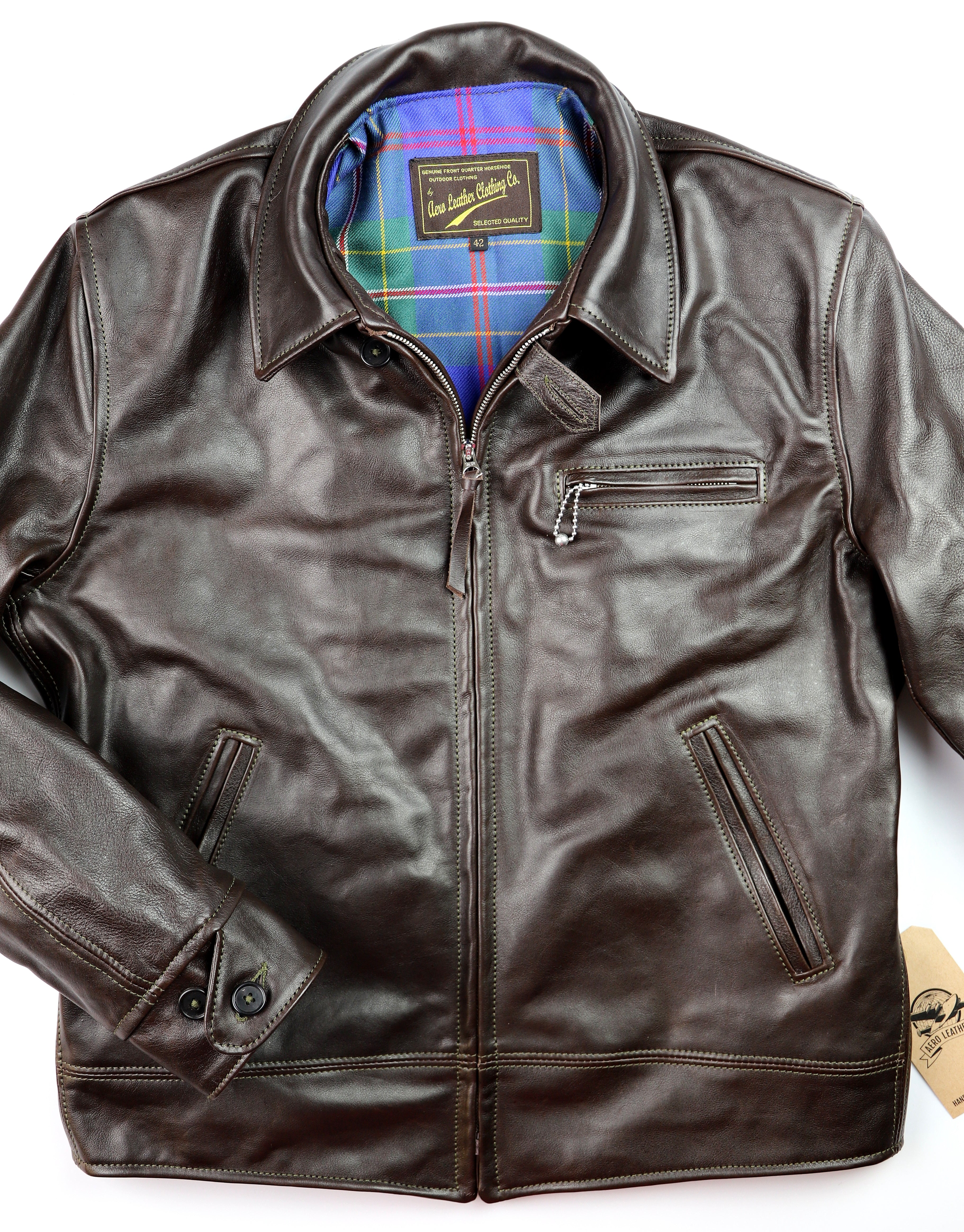 Leather jacket with zipper closure, shirt collar and button cuffs. Throat latch and three-pocket front.