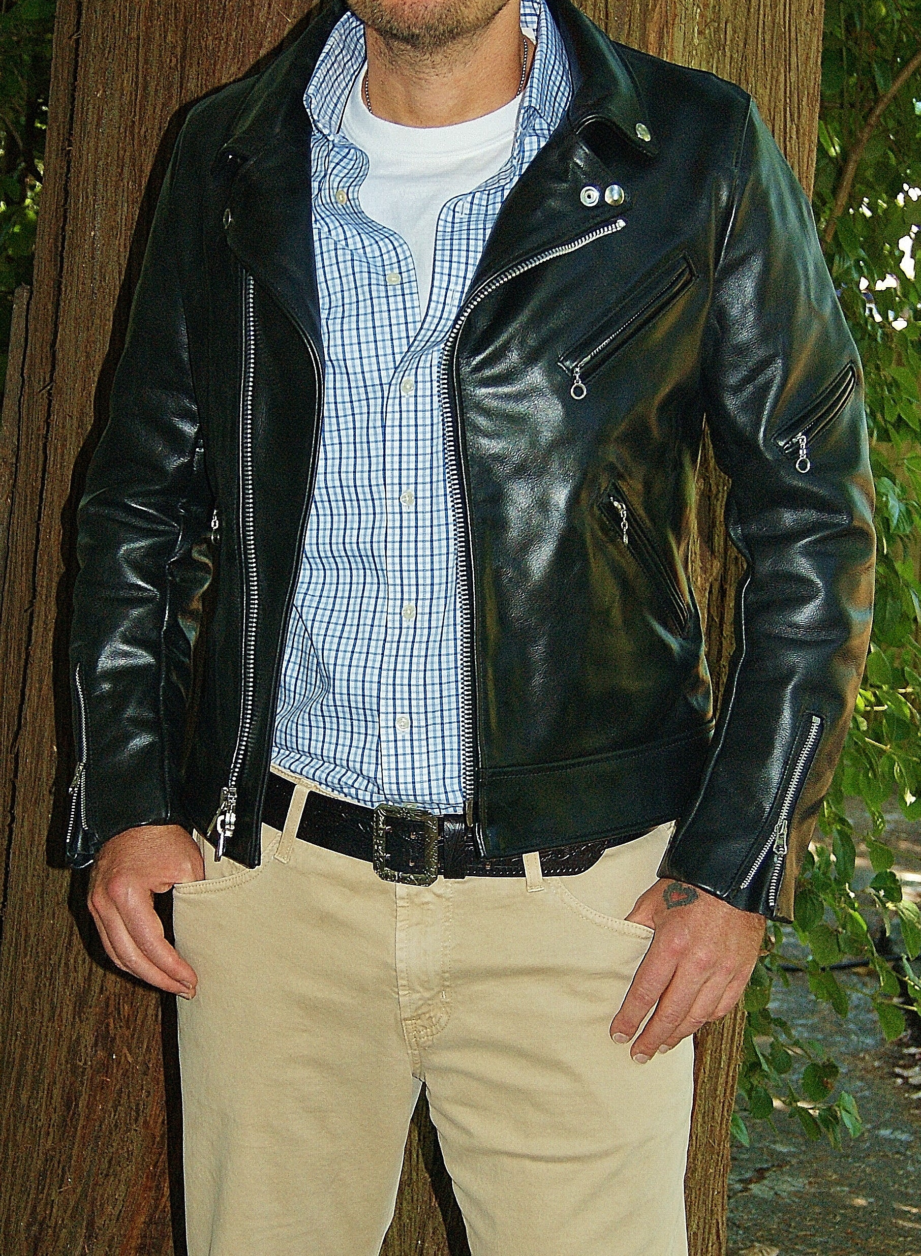Photo of man modelling Vanson Daredevil., black leather motorcycle jacket. Jacket is unzipped.