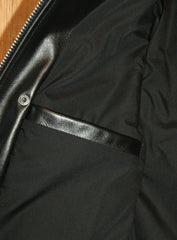 Close-up of right side interior pocket, horizontal opening with no closure.