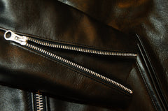 Close-up of zippered sleeves, open to show leather gusset.