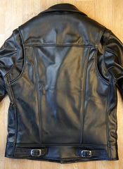 Black of black leather motorcycle jacket.  Shoulder gussets that open.  Small buckles at bottom hem.