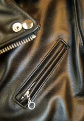 Close-up of angled chest pocket with nickel ring pull.