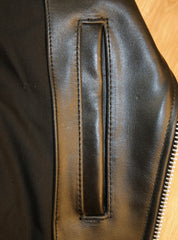 Close-up of left side interior pocket.  Opens vertically with no closure.