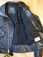 Open photo of black leather motorcycle jacket showing black rayon lining.