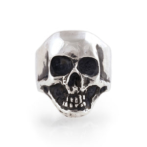 Heavy hand carved sterling silver skull ring