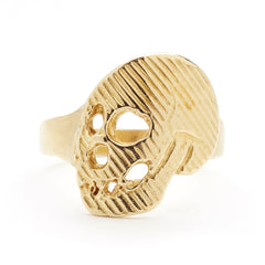 gold tone ring with skull