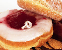 andrew guenther donut ring sitting on yummy jelly donuts
