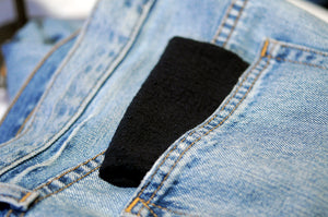 black handkerchief in back pocket of broken in denim