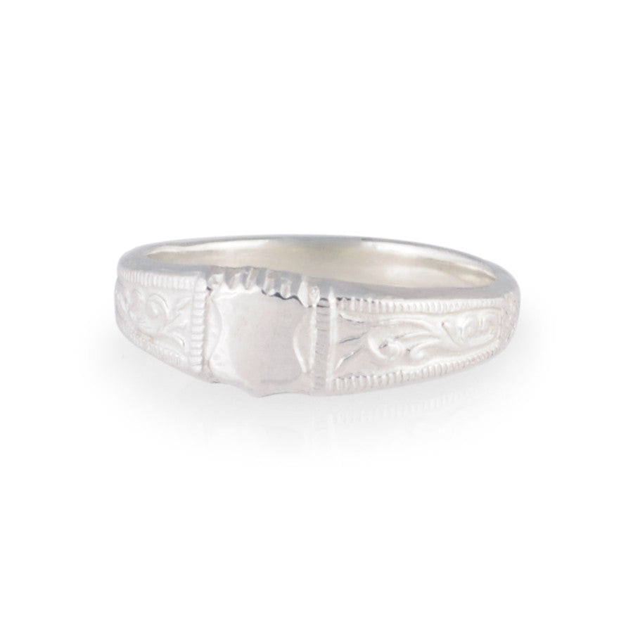 delicate pattern work in sterling silver with milgrain edges
