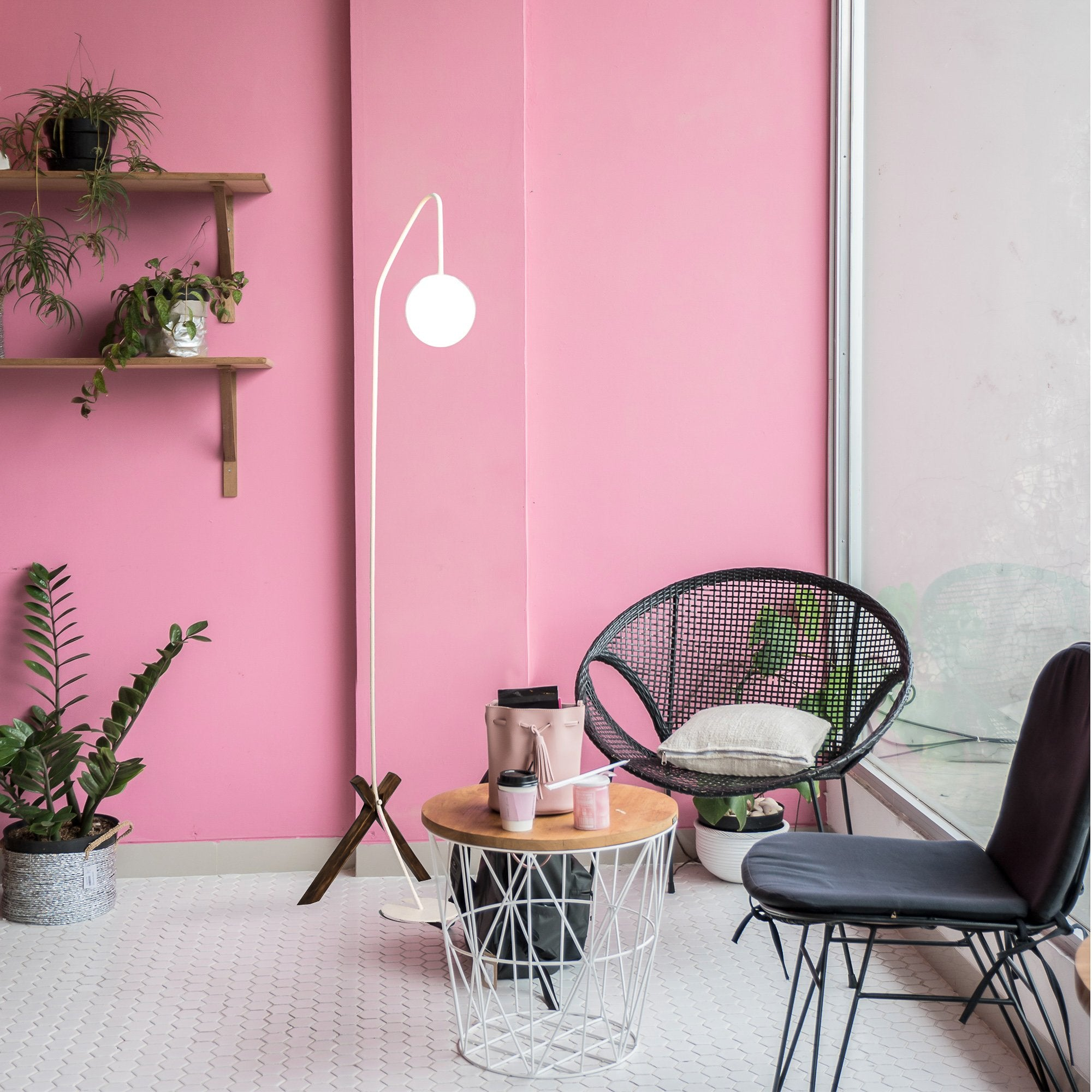 white floor lamp black metal chair wooden base glass frosted ball pink wall interior design