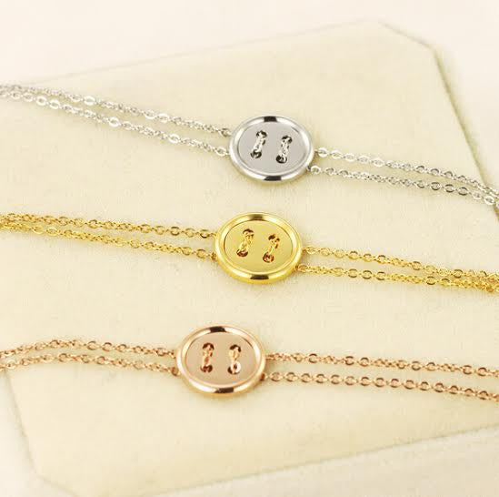 Beautiful Stainless Steel 18ct Plated Button Bracelet