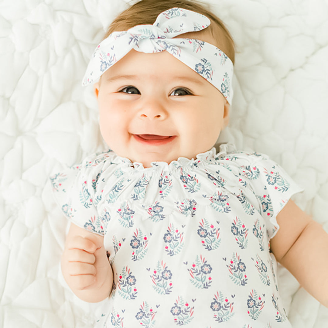 smiling baby wearing a headband