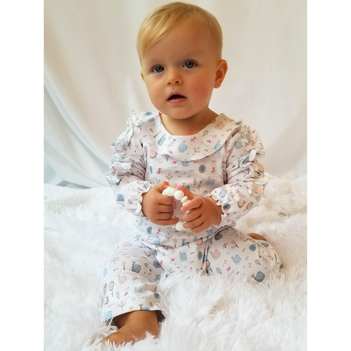 Ruffle Shoulder Romper ~ Snails on White-Feather Baby