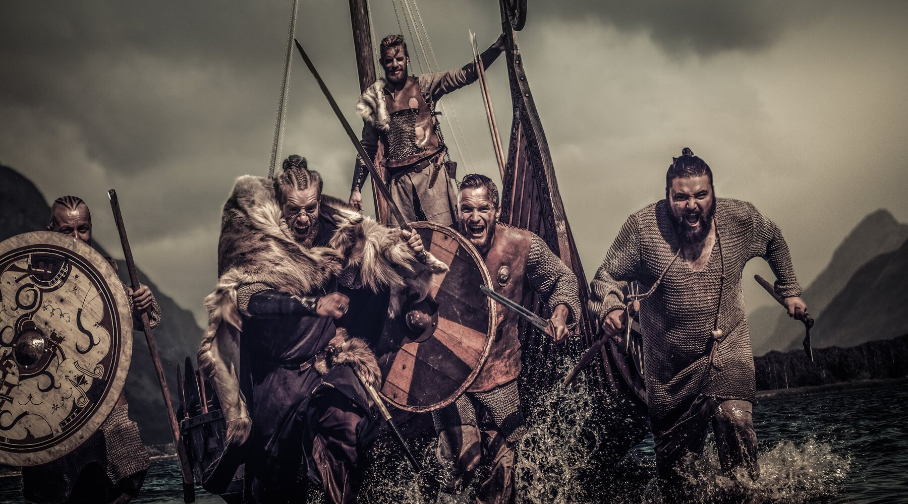 Viking war party carrying various weapons and shields