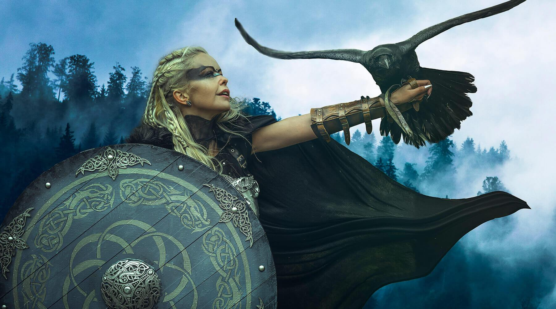 Norse Female Warrior holding a shield and a raven