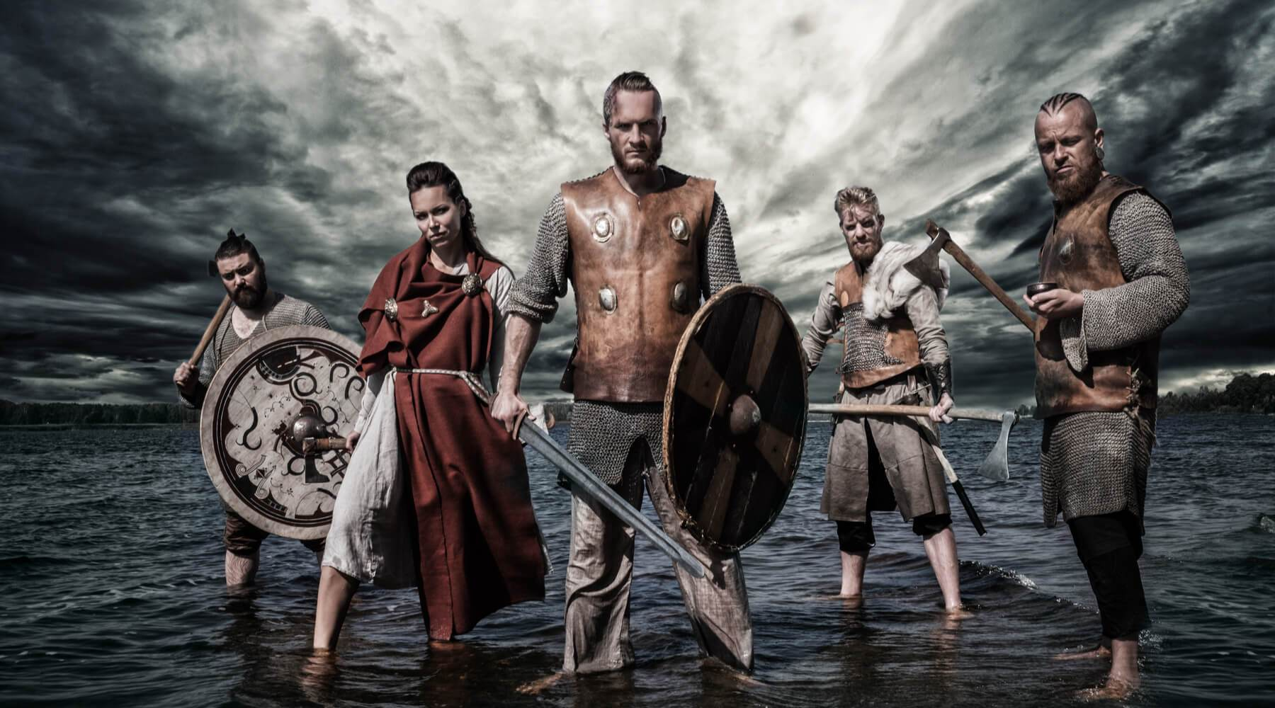 Four Viking warriors and a woman