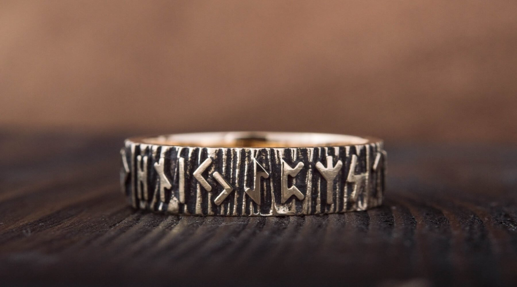Viking wedding ring on a wooden background