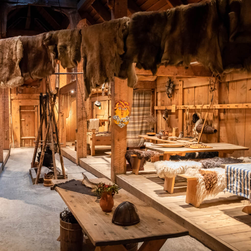 Inside the historic replica of a furnished Viking longhouse
