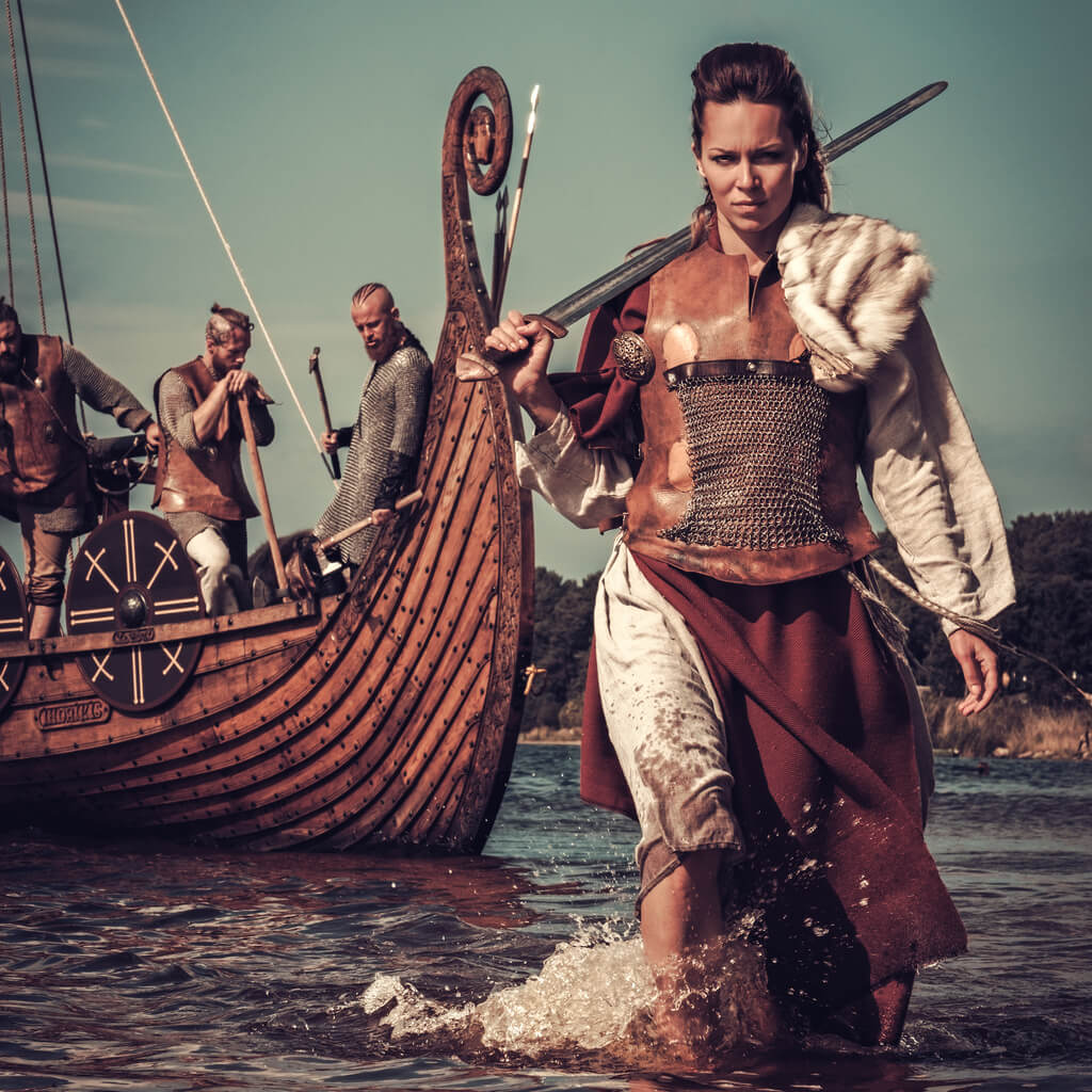 Viking shield maiden coming out of water with a sword