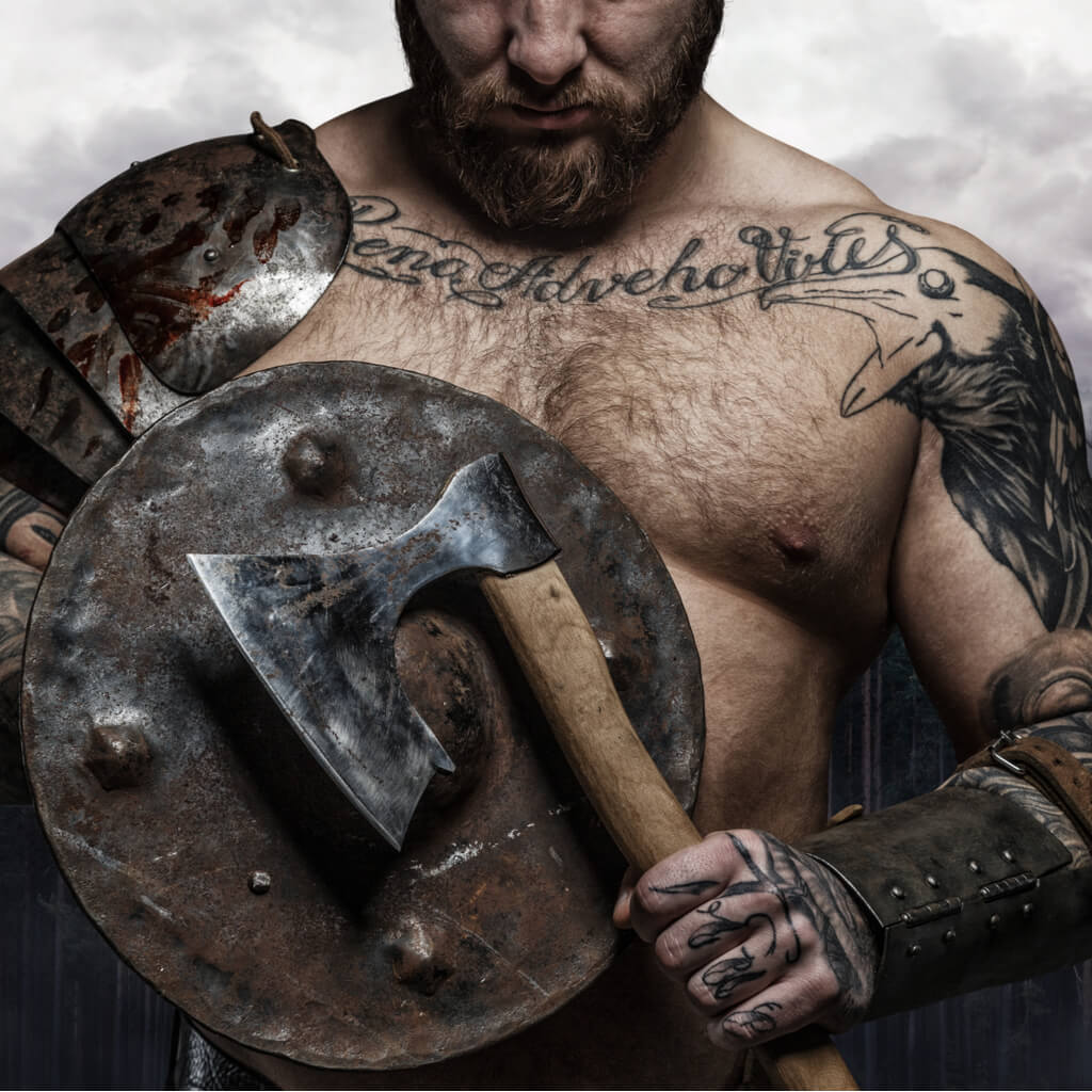 Viking warrior holding an axe and a shield