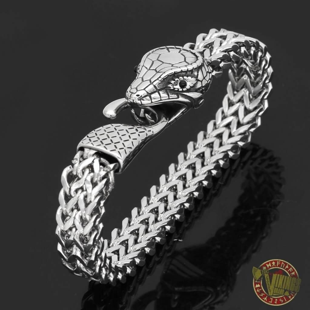 Jormungandr Viking Arm ring made of silver on a black background