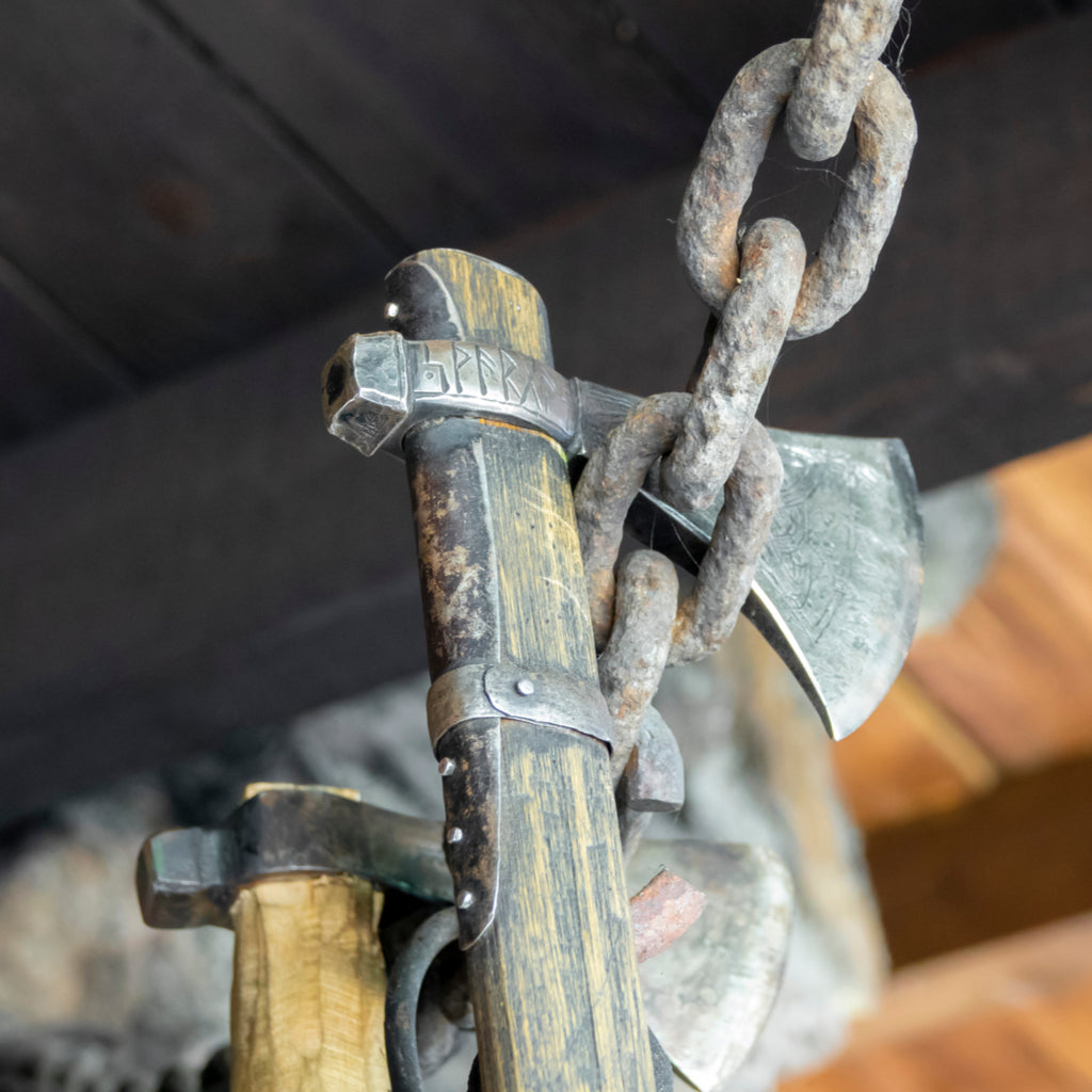 Viking axes hanging-on a chain in a forge