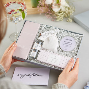 Receiving a 'Gin Night In' gift set with a 'Congratulations' Greetings card