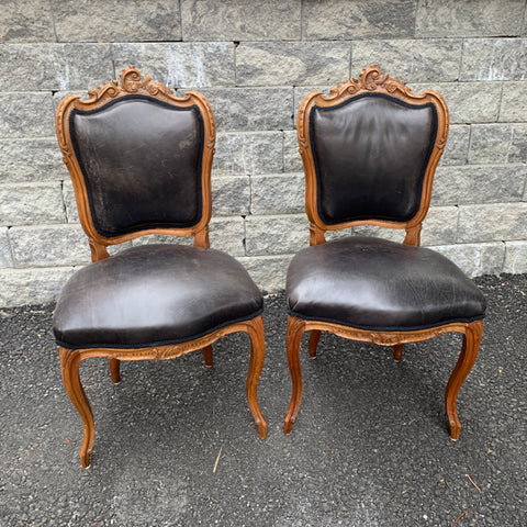 Pair of French Carved Side Chairs with Black Leather Seats