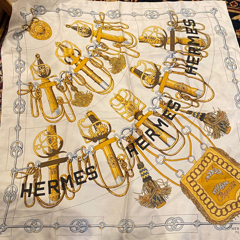 Hermes silk twill scarf featuring white and gold swords in scabbards
