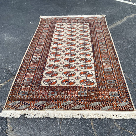 Rust and Beige Bokara Rug 4' x 7'