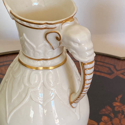 Gold and White Elephant Handle Pitcher