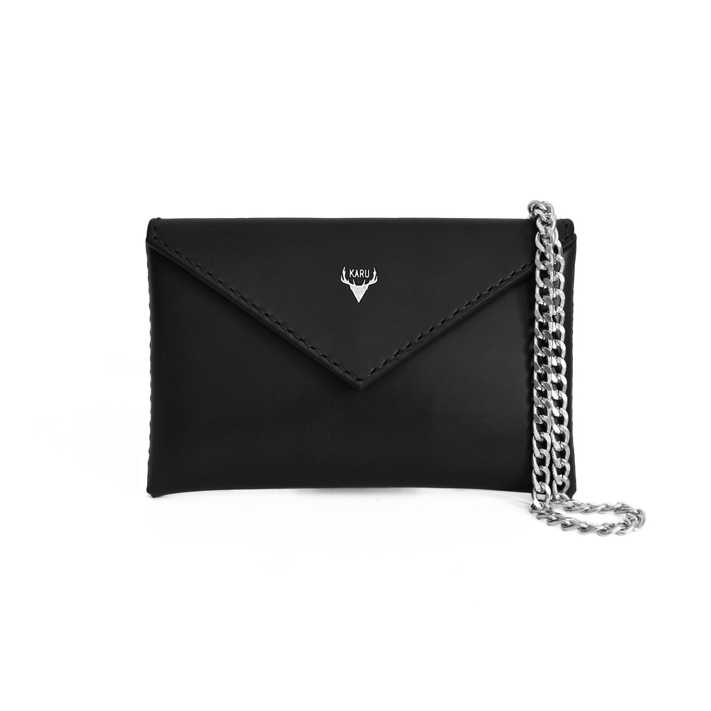 front of handcrafted black leather envelope handbag clutch bag made from vegetable tanned sustainable leather