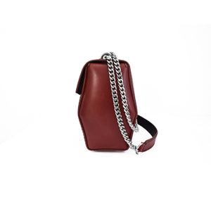 side of burgundy leather lumme shoulder bag crossbody bag handcrafted from vegetable tanned sustainable leather