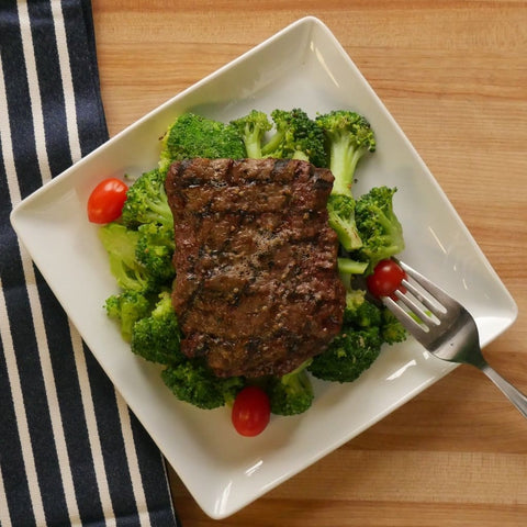 Grilled Flat-Iron Steak Over Buttered Broccoli