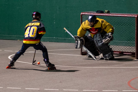 Photo from Tony Hockey of a breakaway in an outdoor roller hockey game at Inter River Park in North Vancouver.