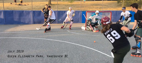 How to Organize Outdoor Roller Hockey Games a photo of players and a goalie and queen elizabeth park in vancouver bc canada