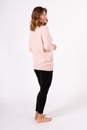 Pullover with side pockets and buttons in back