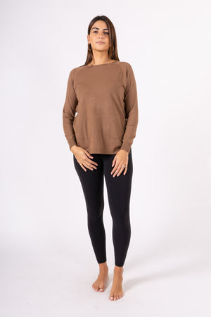 Pullover with buttons on side