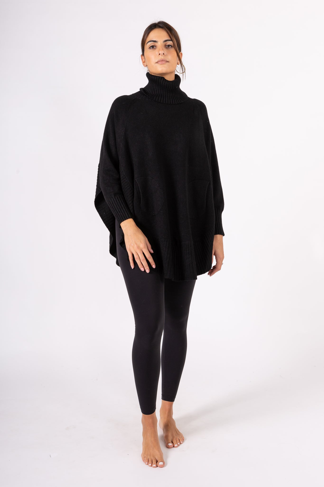 Turtleneck pullover with pockets and open side