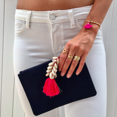 Suede Clutch With Tassel Detail
