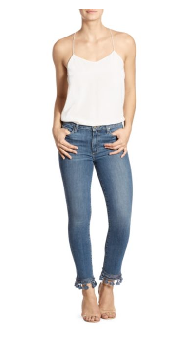 Woman model wearing denim blue jeans, front view