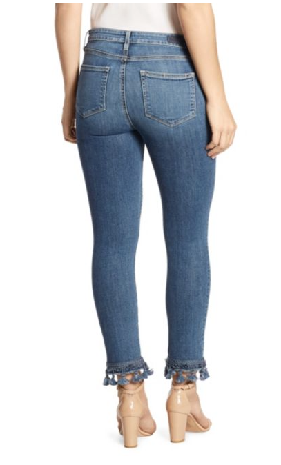 Female model wearing Jaquline Staright Indigo Tassel Women's Jeans, view from the back side