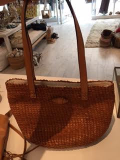 Woven brown bucket leather bag