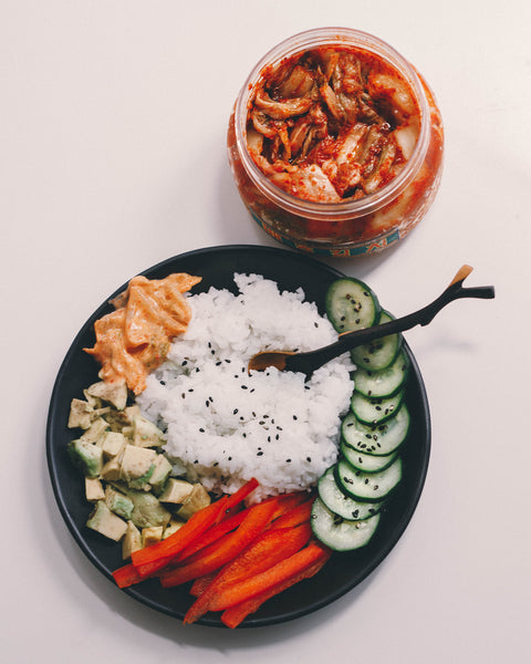 Healthy Korean bowl with rice, avocados, kimchi mayo