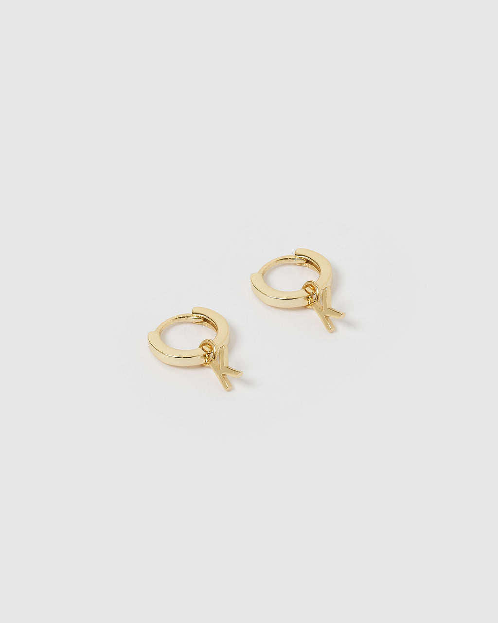 Izoa Alphabet Letter K Huggie Earrings Gold
