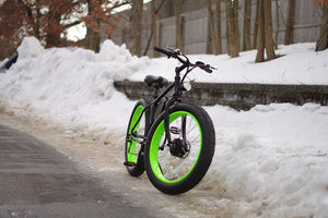 big cat fat cat electric bike, electric bicycle, ebike, fat bike. featuring all terrain tires, 350 watt front hub motor and a lithium ion battery pack