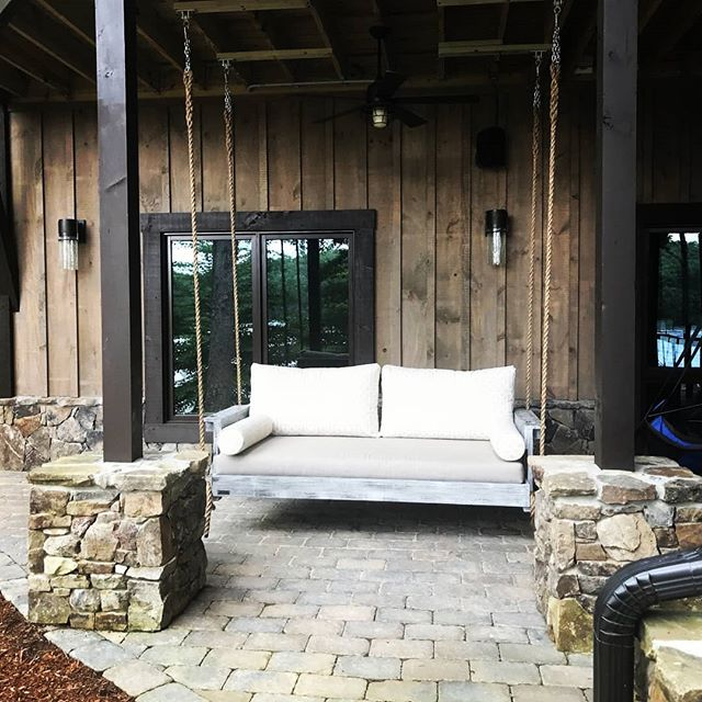 An Essential Piece Of Outdoor Furniture For Any Lake House! . #fouroakbedswings #outdoorliving #interiordesign #lakelife #bedswing #madeinthesouth #love #southernliving @sunbrella #madeinamerica @lakeblueridge