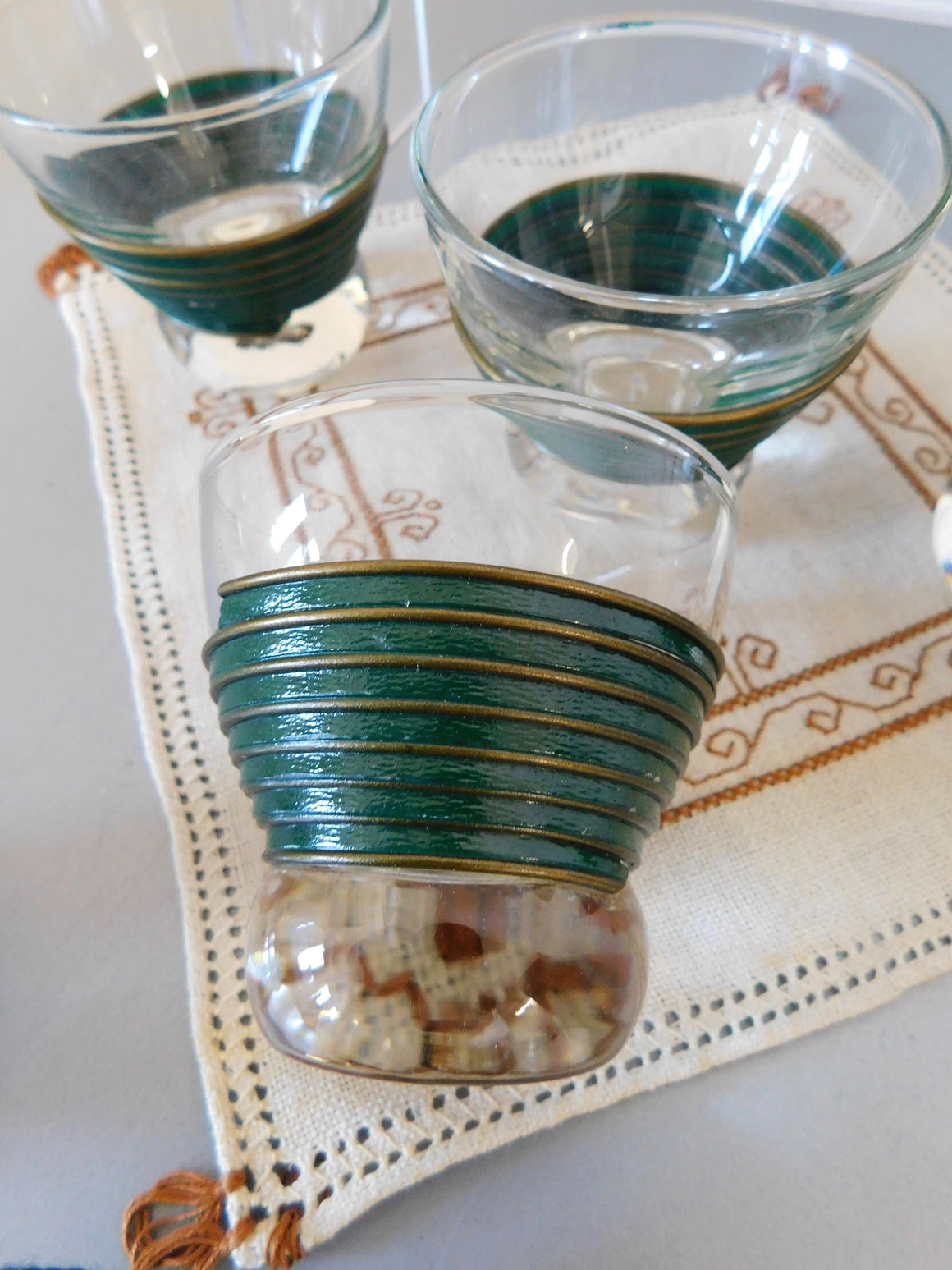 Sweet Heat Spirit Sipper w/ seven vintage metal wrapped cordial glasses circa 1950's