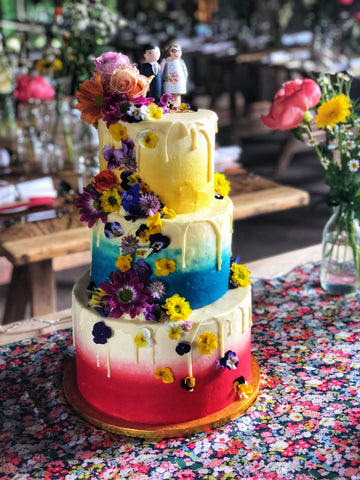 Bright Ombre Tiered Cake Wedding Cake with Edible Flowers